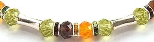 Bild: cb_kette_strassrondelle_glasschliff-rondelle_braun_gruen_orange_metallhanteln_detail